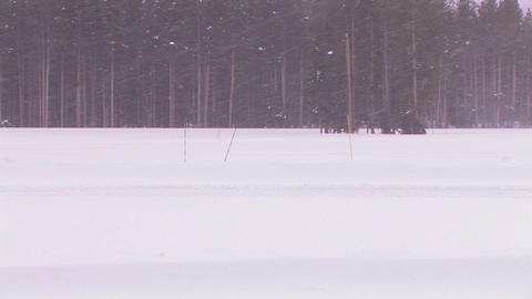 A cross country skier moves across a snowy landsca Stock Video Footage