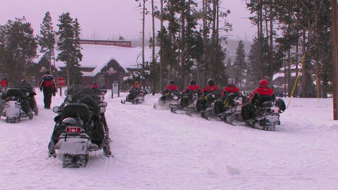 A snowmobile tour prepares to leave Yellowstone Na Footage