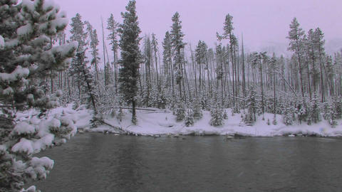 A snowstorm on a frozen lake or stream Stock Video Footage