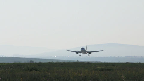Airbus A320 landing at airport Stock Video Footage