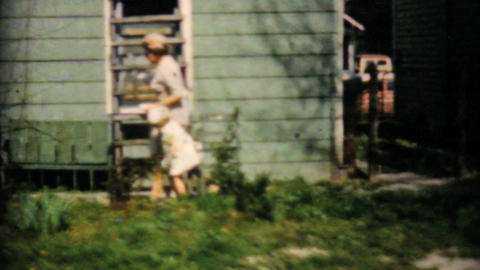 Cute Girl Finds Easter Egg With Grandmother 1961 Stock Video Footage