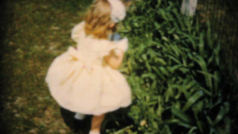 Girl In Yellow Dress Finds Easter Egg 1961 Vintage Stock Video Footage