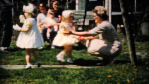 Young Girls Give Easter Eggs To Mother 1961 Footage