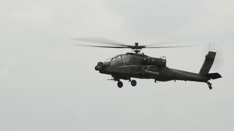 Apache AH 64 Helicopter moving his gun 10968 Stock Video Footage
