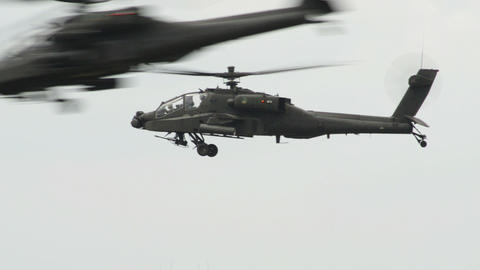 many Apache AH 64 Helicopter traffic crossing 1097 Stock Video Footage