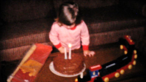 Cute Two Year Old Blows Out Candles On Cake 1961 Footage