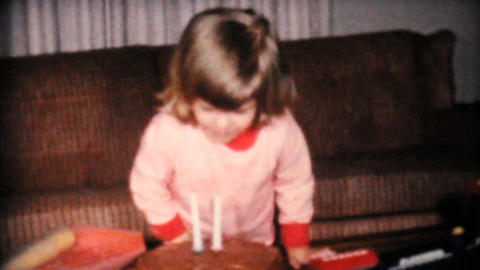 Cute Two Year Old Blows Out Candles On Cake 1961 Stock Video Footage