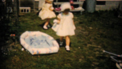 Girls In Dresses Search For Easter Eggs 1961 Stock Video Footage