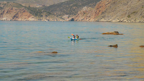 Traveler Kayaking In The Black Sea From Backward V stock footage