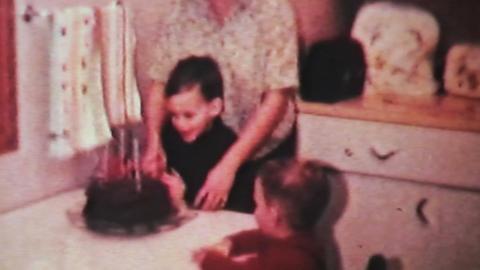 Boy Enjoying His Birthday 1966 Vintage 8mm film Stock Video Footage