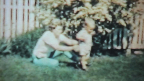Boy Playing With His Grandmother-1963 Vintage 8mm Stock Video Footage