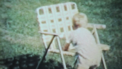 Boy Playing Outside In The Yard-1963 Vintage 8mm f Stock Video Footage