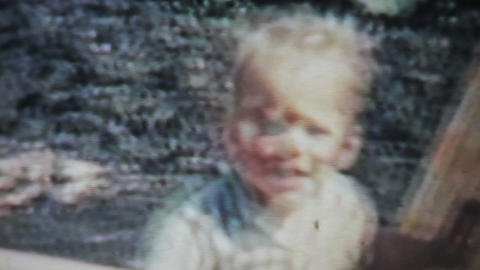 Boy Playing Outside In The Yard-1963 Vintage 8mm F stock footage