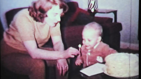 Boy Blows Out Birthday Candle-1965 Vintage 8mm fil Stock Video Footage