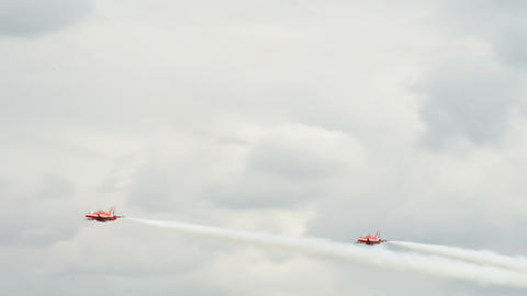 Red Arrows four soloists crossing 10972 Stock Video Footage