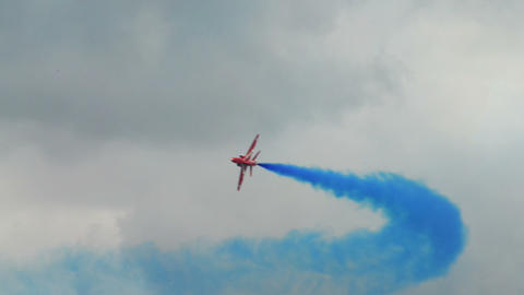 Red Arrows two soloists crossing carousel 10982 Footage