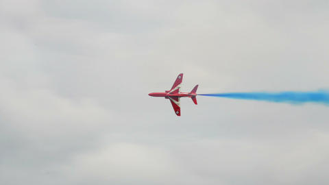 Red Arrows two soloists crossing carousel 10982 Stock Video Footage