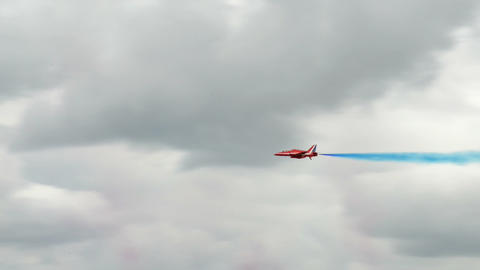 Red Arrows soloists roll flight encounter 10996 Stock Video Footage