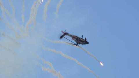Apache AH 64 Helicopter looping with flares 11000 Stock Video Footage