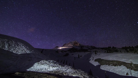 Night Stars at Mt. Hood with Snow Groomer Working Stock Video Footage