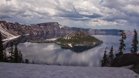 Pan shot of Crater Lake on a Cloudy Afternoon Footage