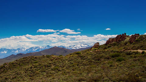 Snow Mountains Landscape Background by a Sandy Roa Live Action
