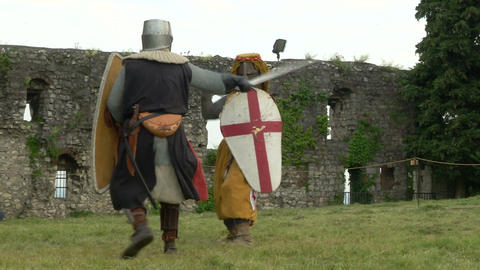 medieval fighting slow motion yellow red blu 02 Stock Video Footage
