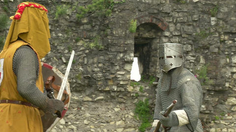 medieval fighting slow motion yellow steel 01 Stock Video Footage