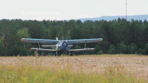 Antonov An-2 russian retro biplane aircraft takeof Stock Video Footage