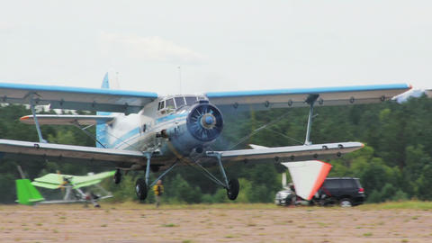 Antonov An-2 Russian Retro Biplane Aircraft Takeof stock footage