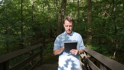 Man with iPad in Forest Stock Video Footage