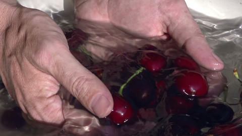 Cherry in water HD Stock Video Footage