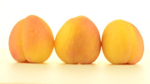 Three peaches rotating Stock Video Footage