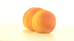 Three peaches rotating Stock Video Footage