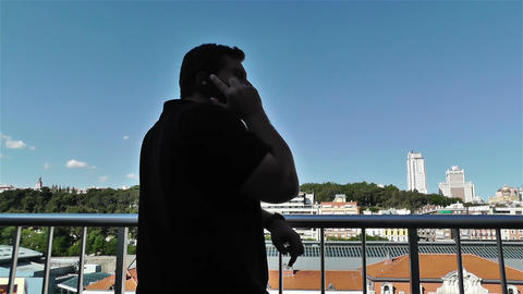 Man Talking Phone in Balcony 1 Stock Video Footage