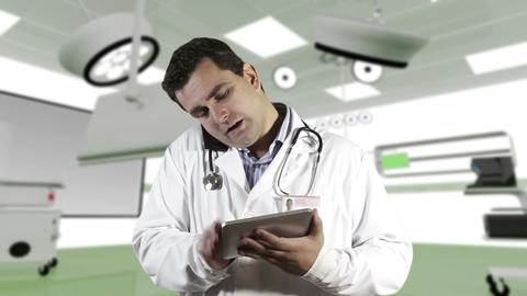 Young Doctor Tablet PC Cell Phone Operation Room 2 Stock Video Footage