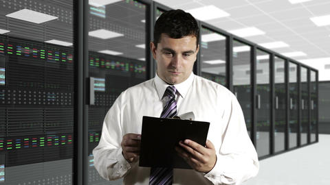 Young Man Checking Documents CPU Server Unit Room Stock Video Footage