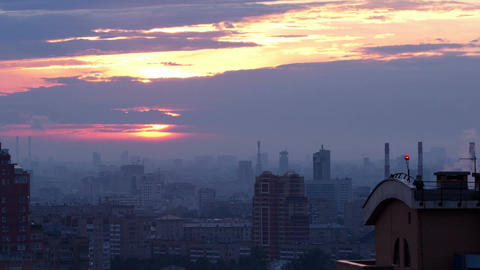 Sunrise over the city. Time lapse with panning Stock Video Footage