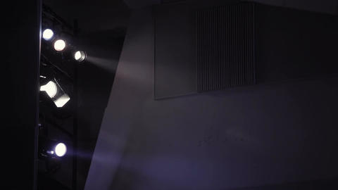 Five floodlights in theatre Stock Video Footage