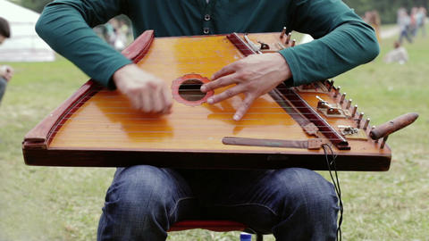Folk musician playing gusli Stock Video Footage
