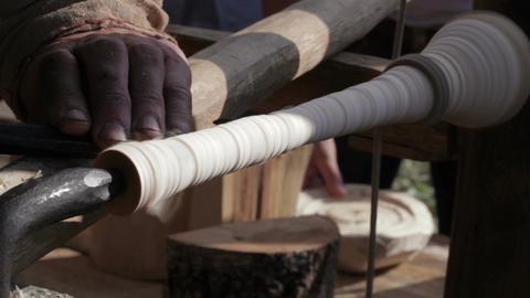 Craftsman turning wood on a vintage lathe Stock Video Footage