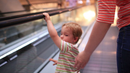 Little boy rises on the escalator Footage