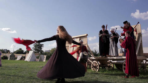 Folk musicians and woman dancer 2 Stock Video Footage