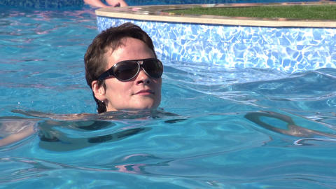 Swimming in the Pool HD Stock Video Footage