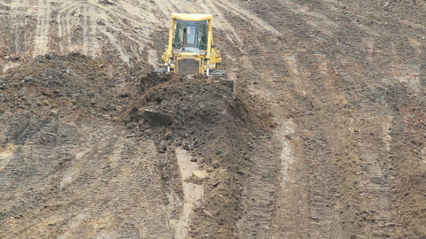 Yellow Bulldozer Raking Clay Stock Video Footage