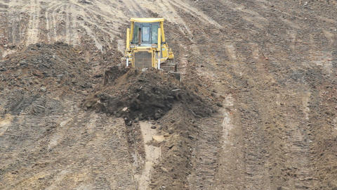 Yellow Bulldozer Raking Clay stock footage