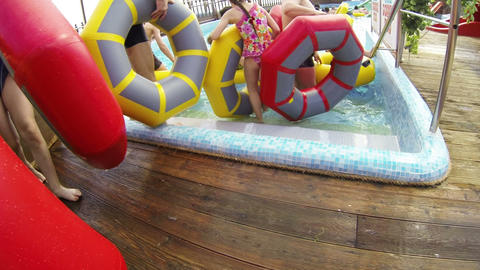 People swim on the inflatable circles in the water Stock Video Footage