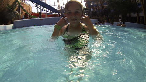 Little girl bathing in the water Park Stock Video Footage