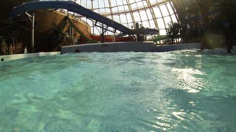 Children riding on a wave in the water Park Stock Video Footage