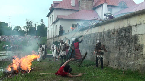 The battle for the fortress of medieval warriors Stock Video Footage